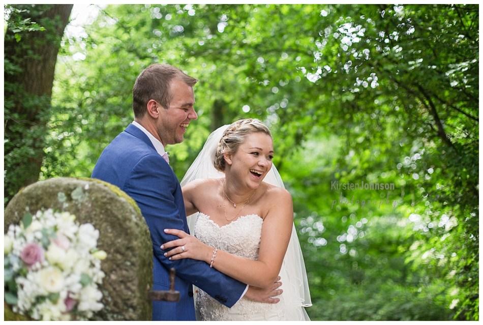 bride laughing behind her with groom