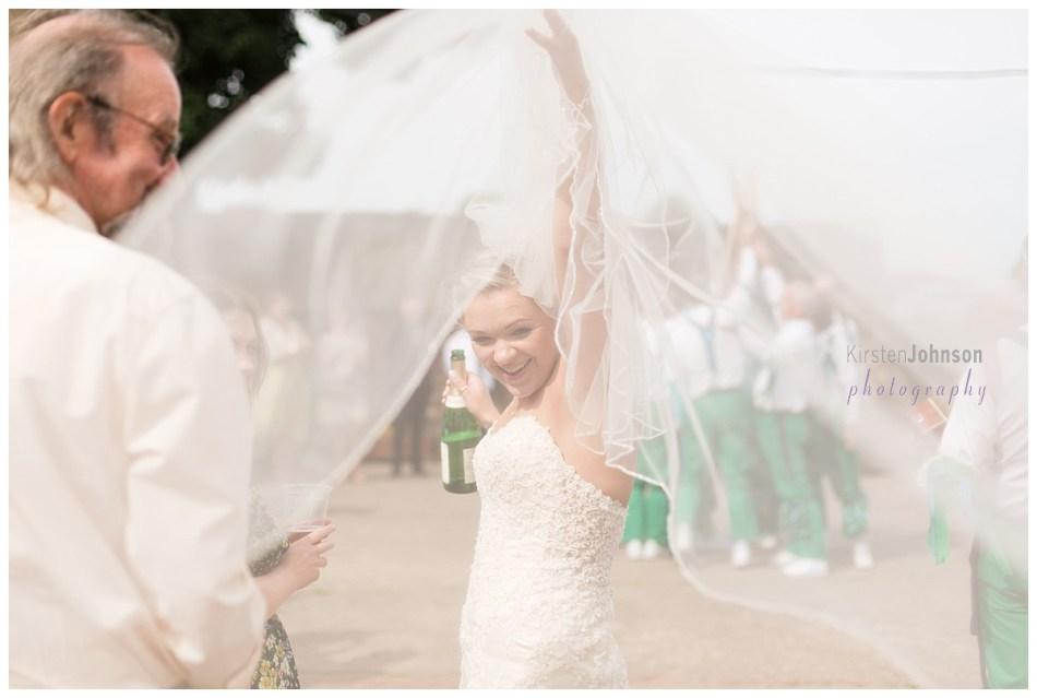 bride looking back through her veil