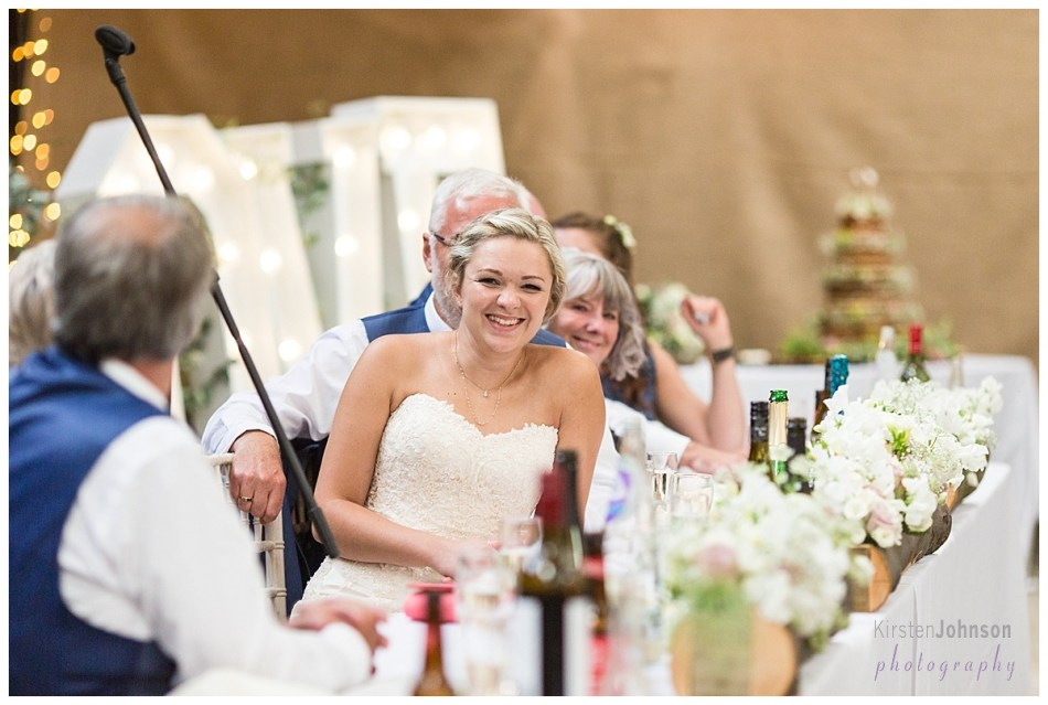 bride at top table smiling