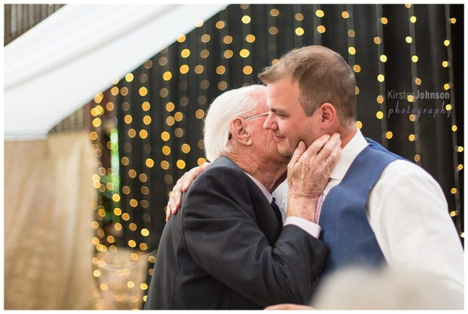 grandad hugging groom