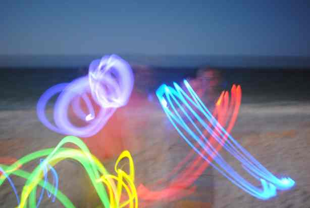 Family glow stick photos at night.