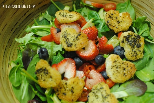 A simple salad with spring mix, fruit, and heart-shaped croutons. Perfect for Valentines or any other night.