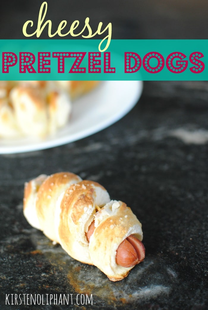 Cheesy pretzel dogs take hot dogs to a whole new level. Soft and fluffy bread with the sharp bite of cheddar--your whole family will love them!