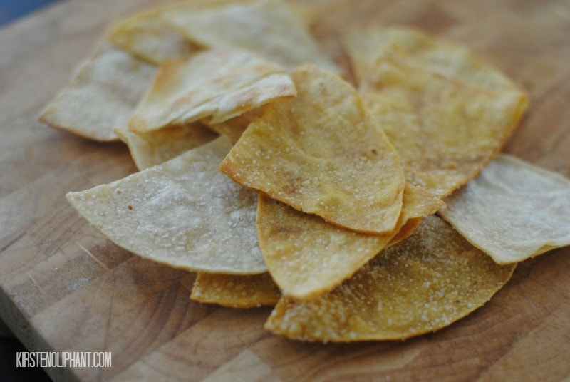 These baked tortilla chips are easy, crispy, and delicious. Plus much healthier than their deep fried alternatives!