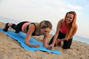 press ups & teamwork on the beach