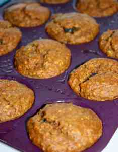 These Sweet Potato Muffins loaded with raisins and spices are a moist and delicious breakfast or snack choice.  They are so moist and tasty that you won't believe they are gluten free!