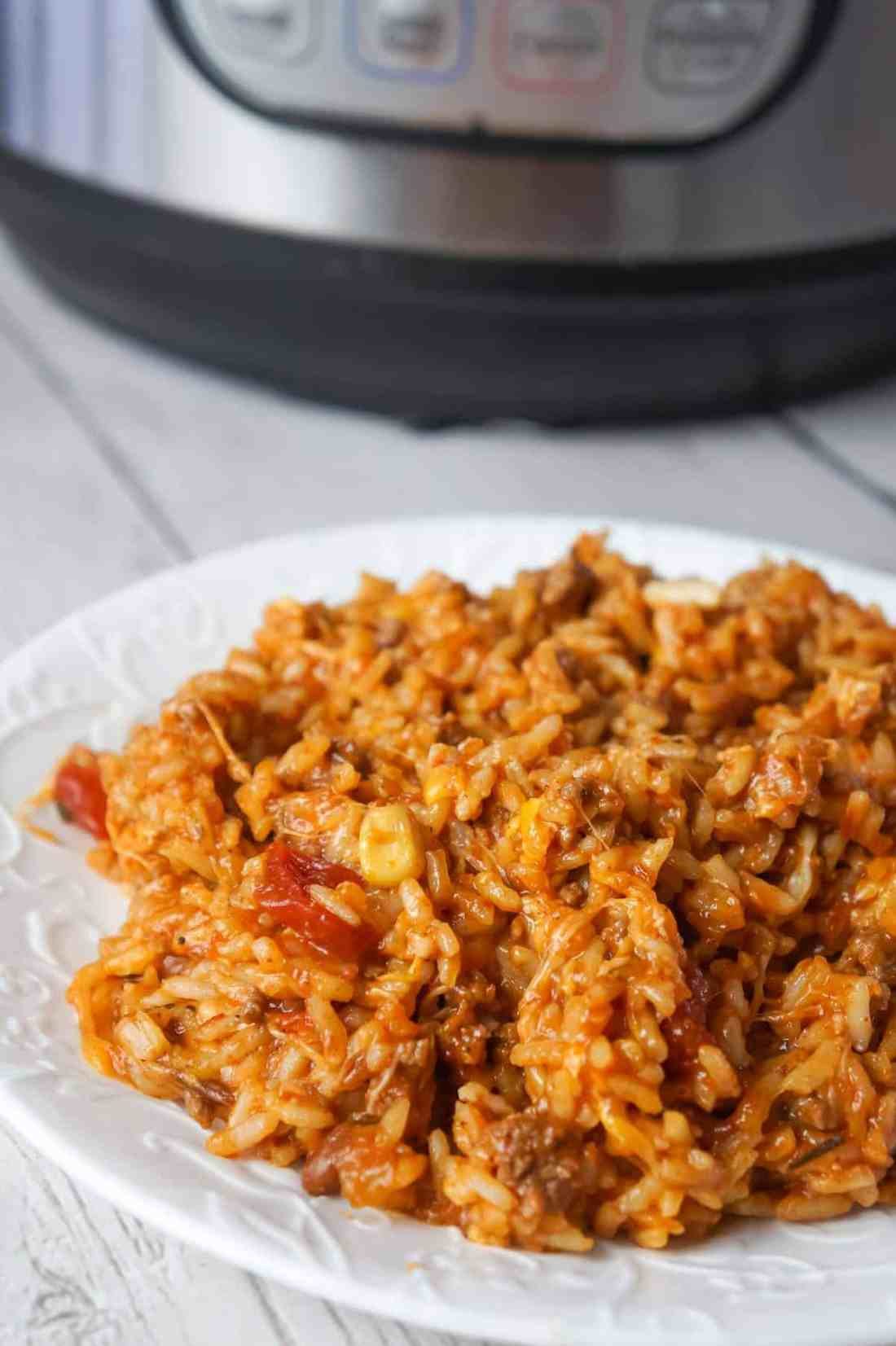 Instant Pot Cheesy Taco Ground Beef and Rice is an easy pressure cooker ground beef dinner recipe made with long grain white rice, corn and black bean salsa and Heinz chili sauce and loaded with shredded mozzarella and cheddar cheese.
