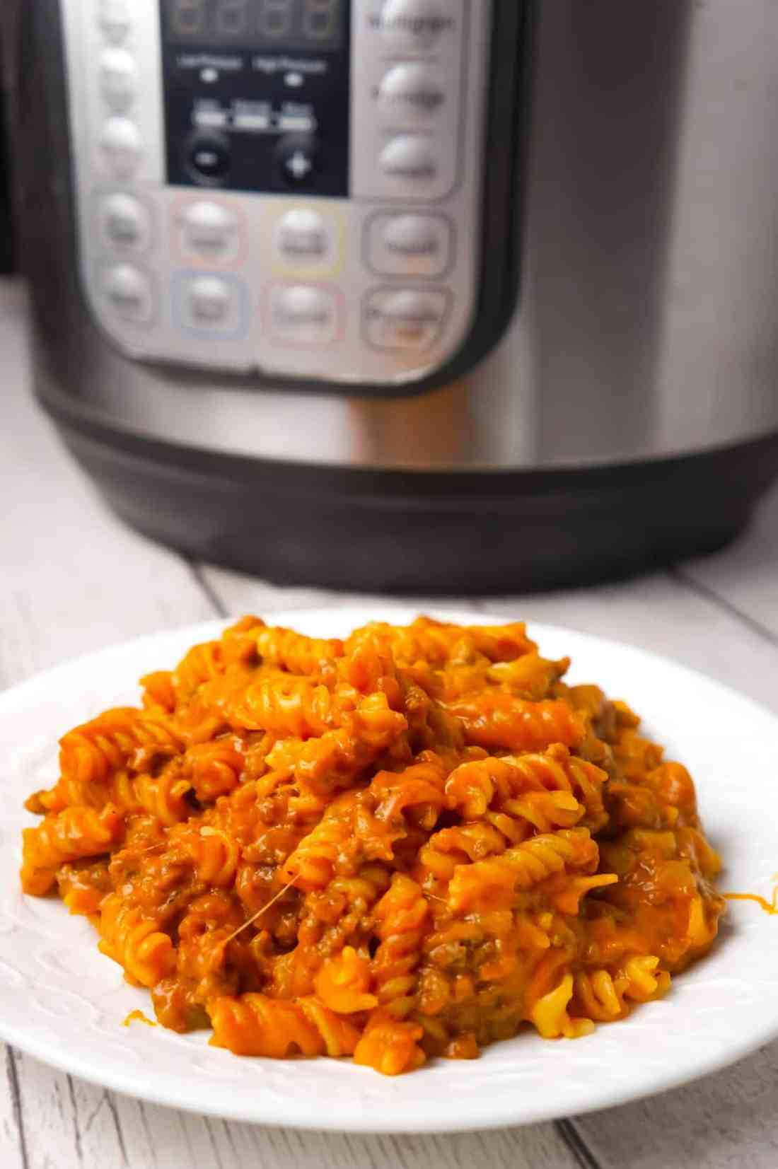 Instant Pot Cheesy Sloppy Joe Pasta is an easy gluten free pasta recipe loaded with ground beef, homemade sloppy joe sauce, mozzarella and cheddar cheese.