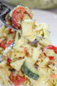 Loaded Coleslaw is a refreshing side dish in the warmer weather. This colourful salad is loaded with bacon, tomatoes, cucumbers, Asian pears and then smothered in a slightly sweet yet tangy dressing.