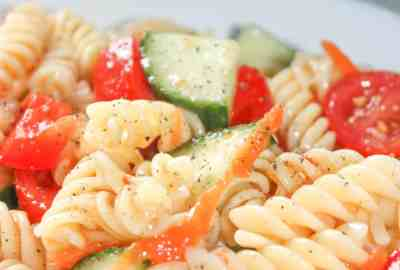 Easy Pasta Salad is a tasty cold side dish recipe loaded with chopped vegetables and tossed in Zesty Italian dressing. This gluten free pasta salad is a quick and easy recipe that even those that can consume gluten will enjoy!