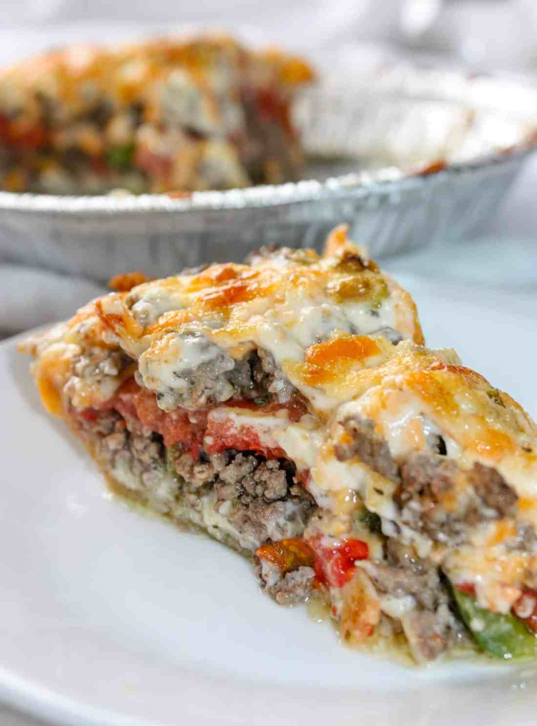 Beef and Tomato Pie is a delicious dinner recipe filled with ground beef, cheese, tomatoes and spices.