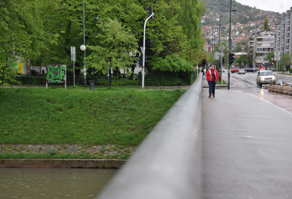 Lejla Kalamujić on the bridge she crossed during the war in Sarajevo