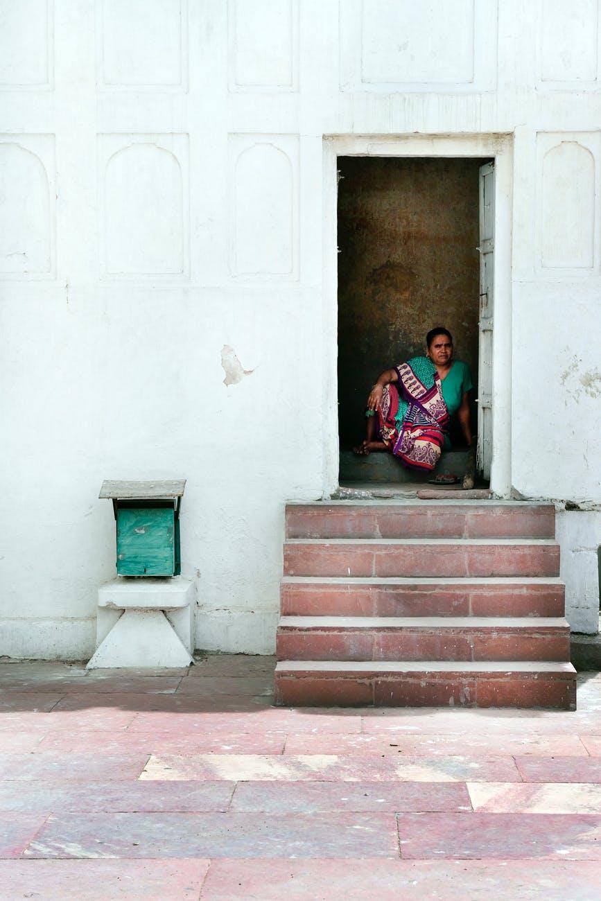 woman sitting inside house