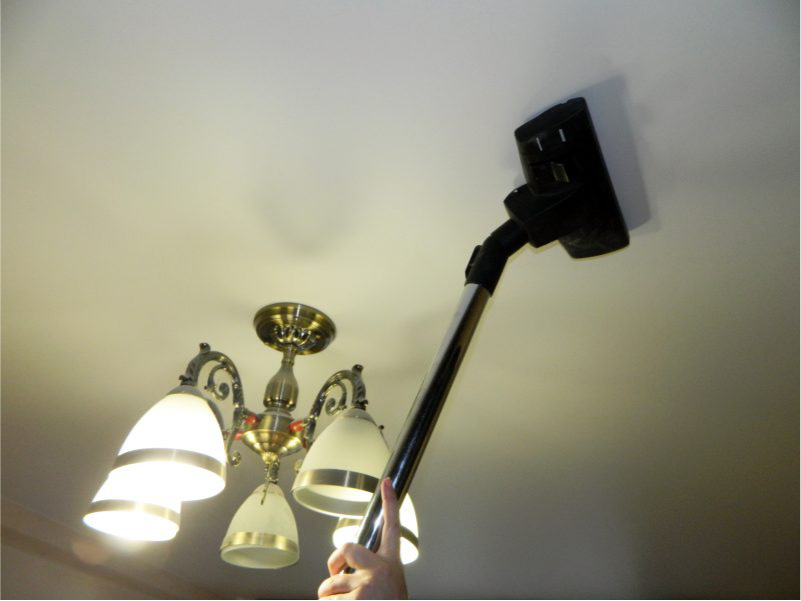 Cleaning stretch ceiling with a vacuum cleaner