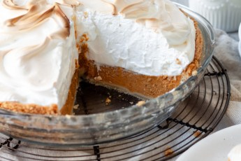 Pumpkin Meringue Pie with slices out of it