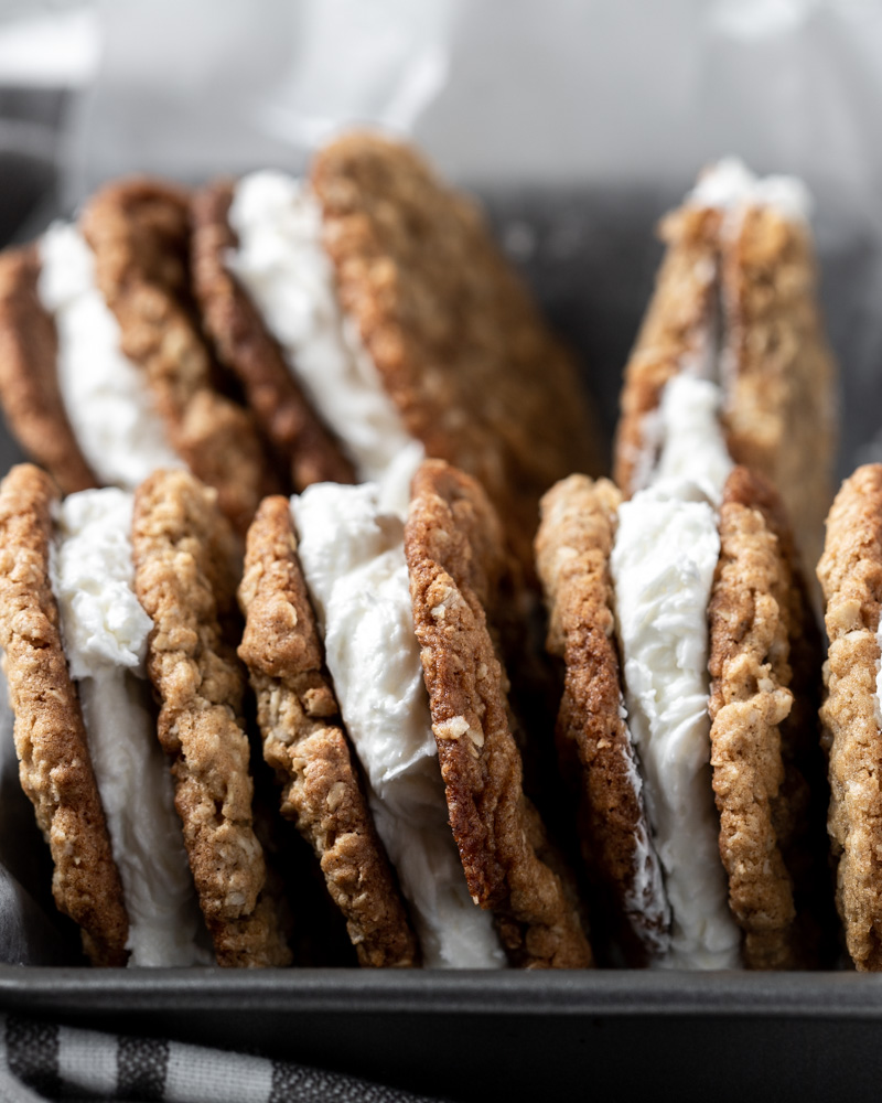 A side view of oatmeal cream pies in a pan
