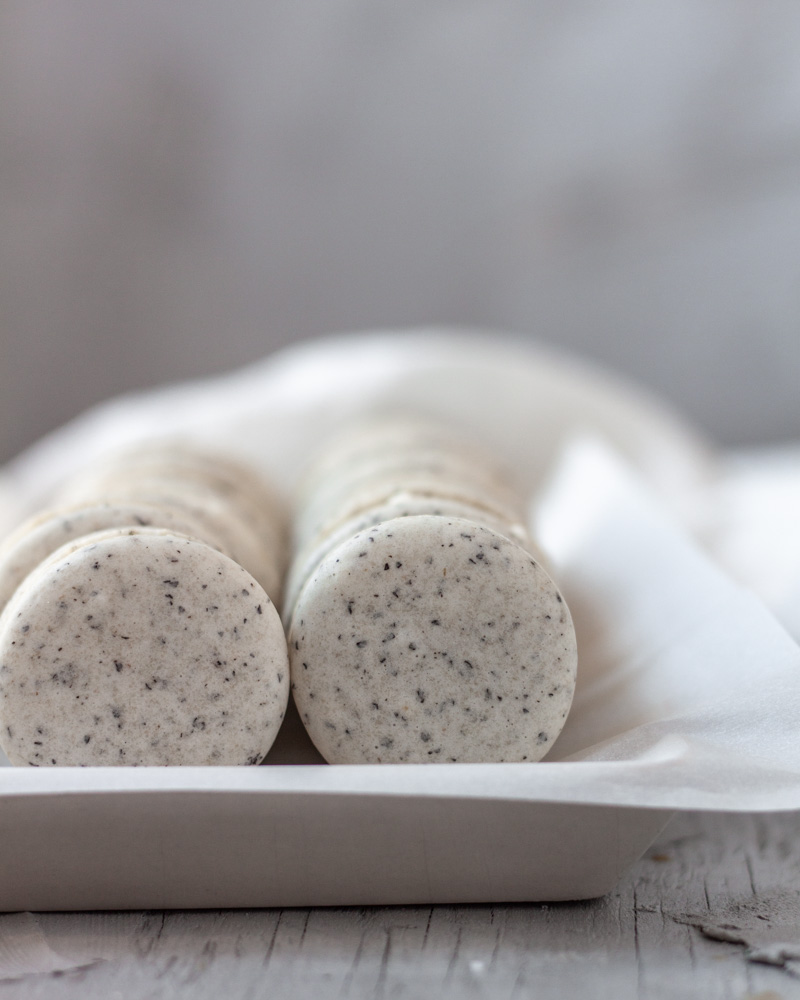 two rows of macarons in a dish