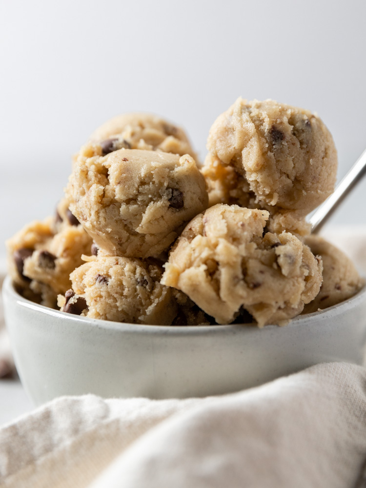 A close up of scoops of cookie dough in a bowl