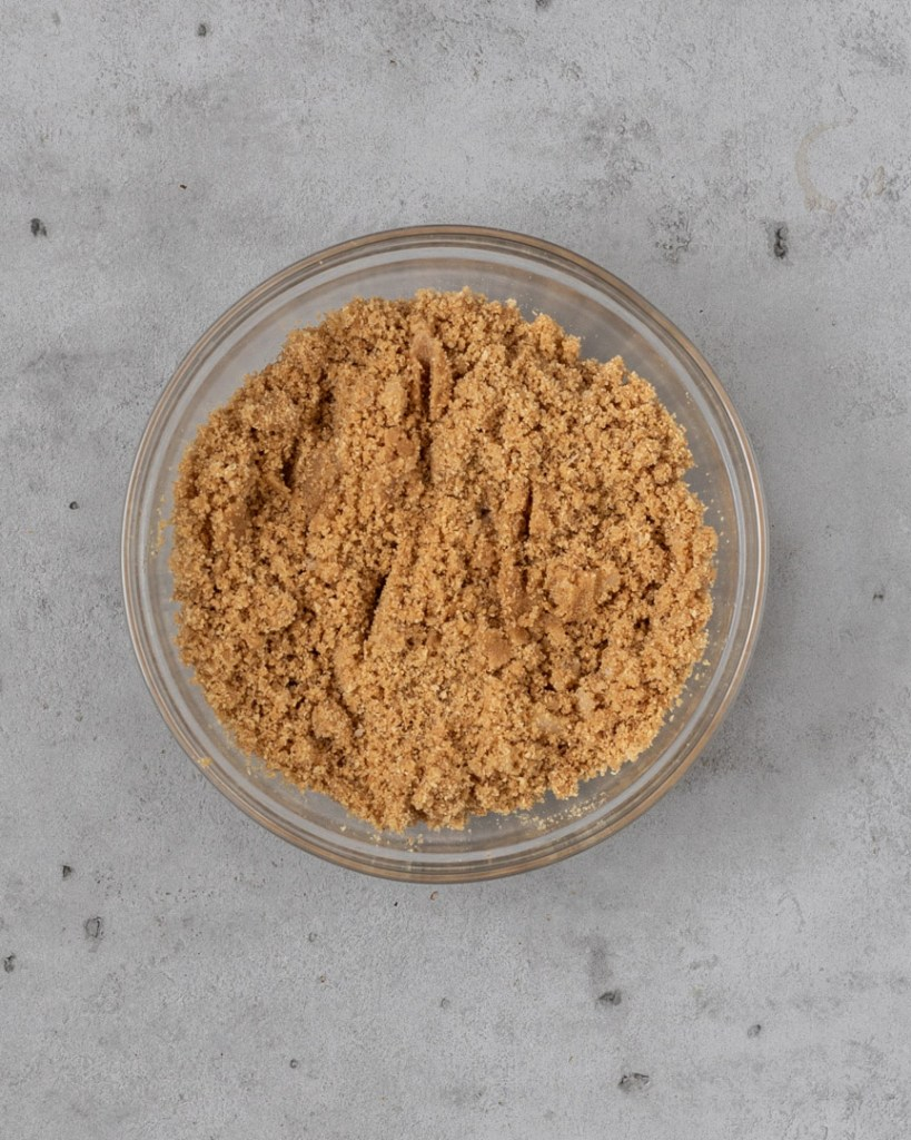 The ingredients for a homemade graham cracker crust in a bowl