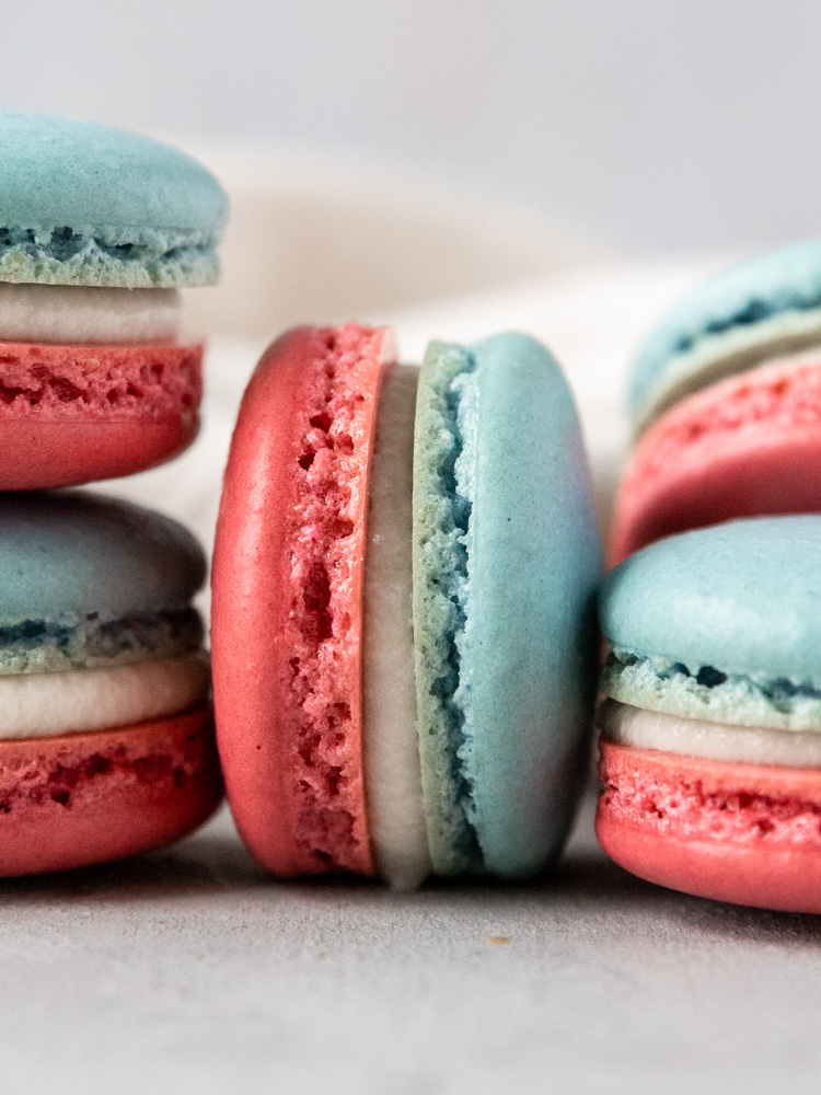 A close up of a red white and blue macaron on its side