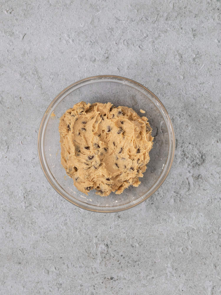 The chocolate chip cookie dough in a bowl