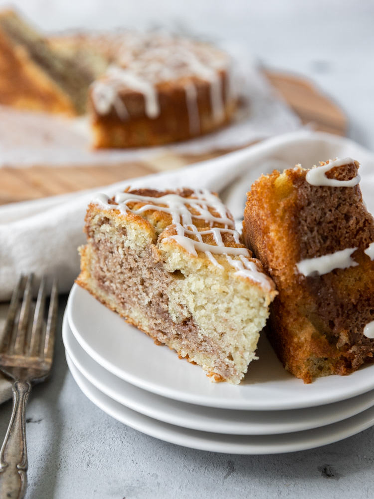 Two slices of maple coffee cake on a stack on plates