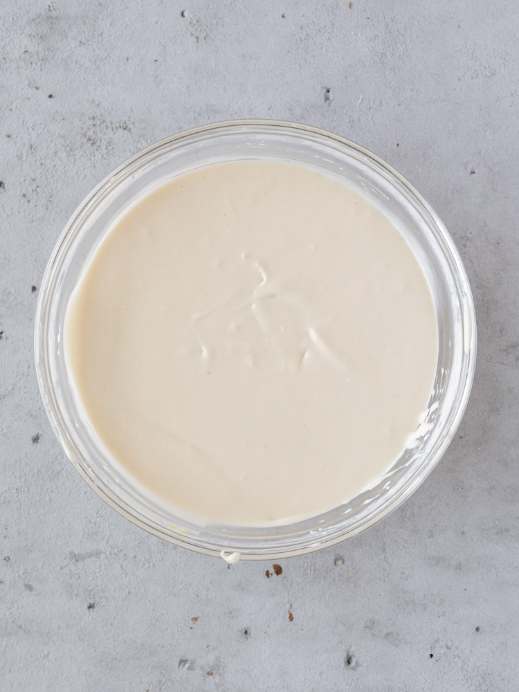 The cheesecake filling in a bowl