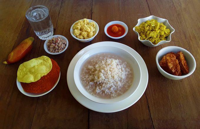 Traditional supper of paej (unpolished par-boiled rice gruel) with ambya phulla chutney (mango blossoms chutney) accompanied by kadgi chakko (tender jackfruit side dish), ponsa kadgi podi (deep-fried tender jackfruit chips), papodu (papads), mirsange appolu (chili papads) and odis (deep-fried, sun-dried spicy rice balls), and a lick of acerola cherry pickle.