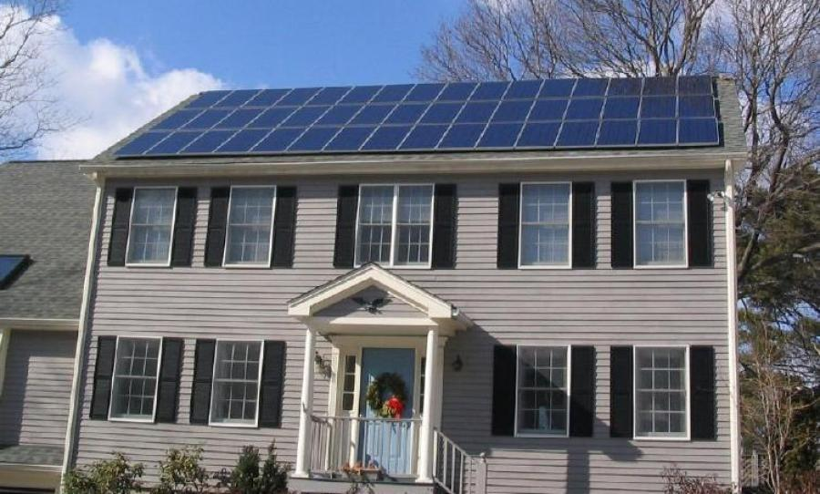 Eco Green Construction Solar_panels_on_house_roof_winter_view