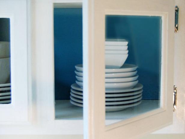 kitchen-cabinet-glass-doors-blue-paint-back-walls-accent