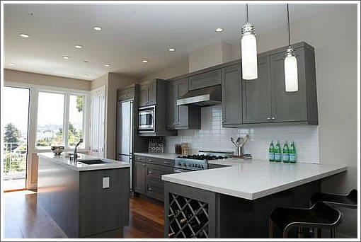 Dark grey variation on custom-cabinet kitchen remodeling and renovation.