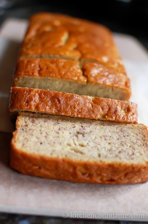 a sliced loaf of buttermilk banana bread