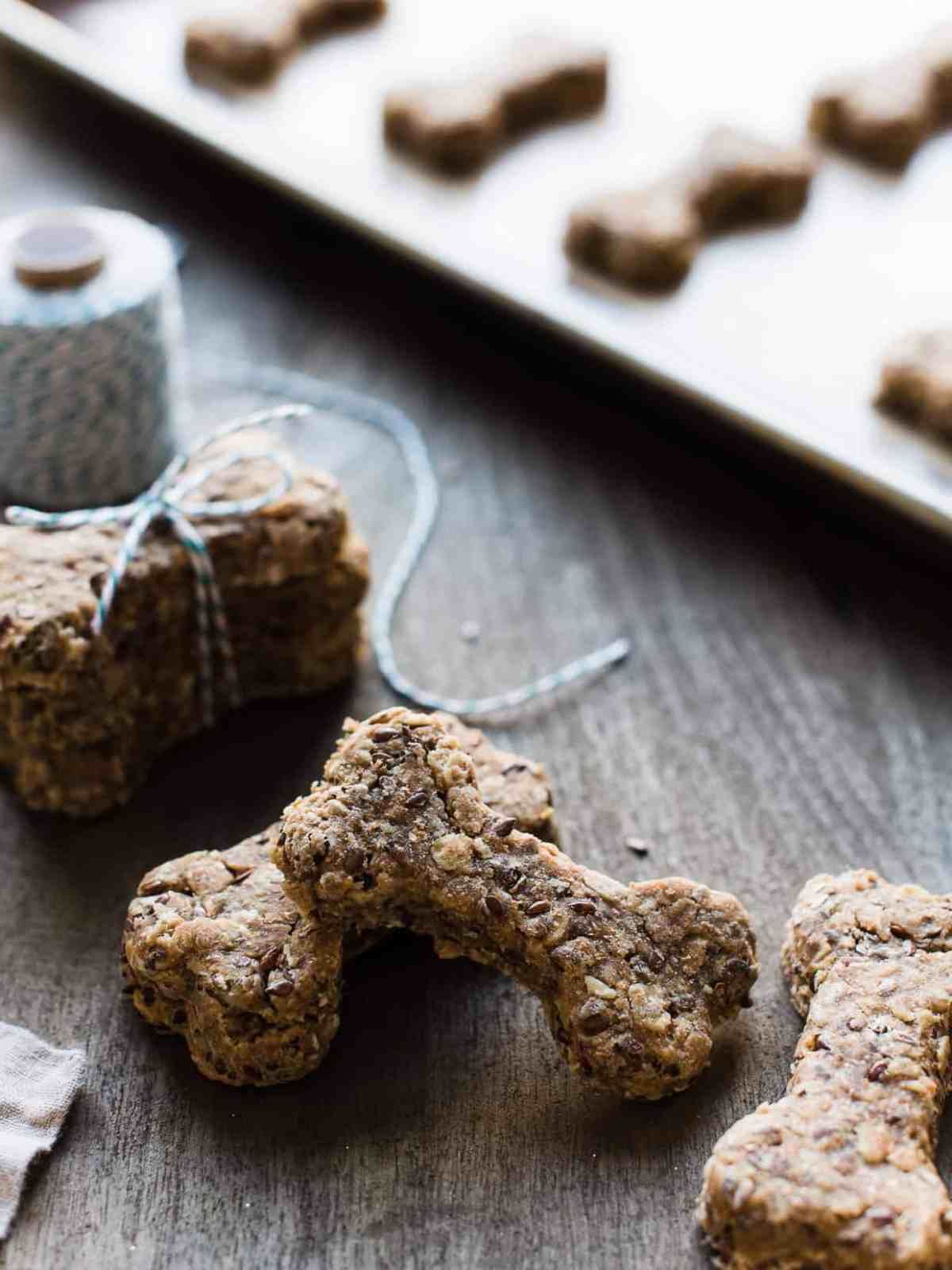 Homemade dog biscuits stacked on table