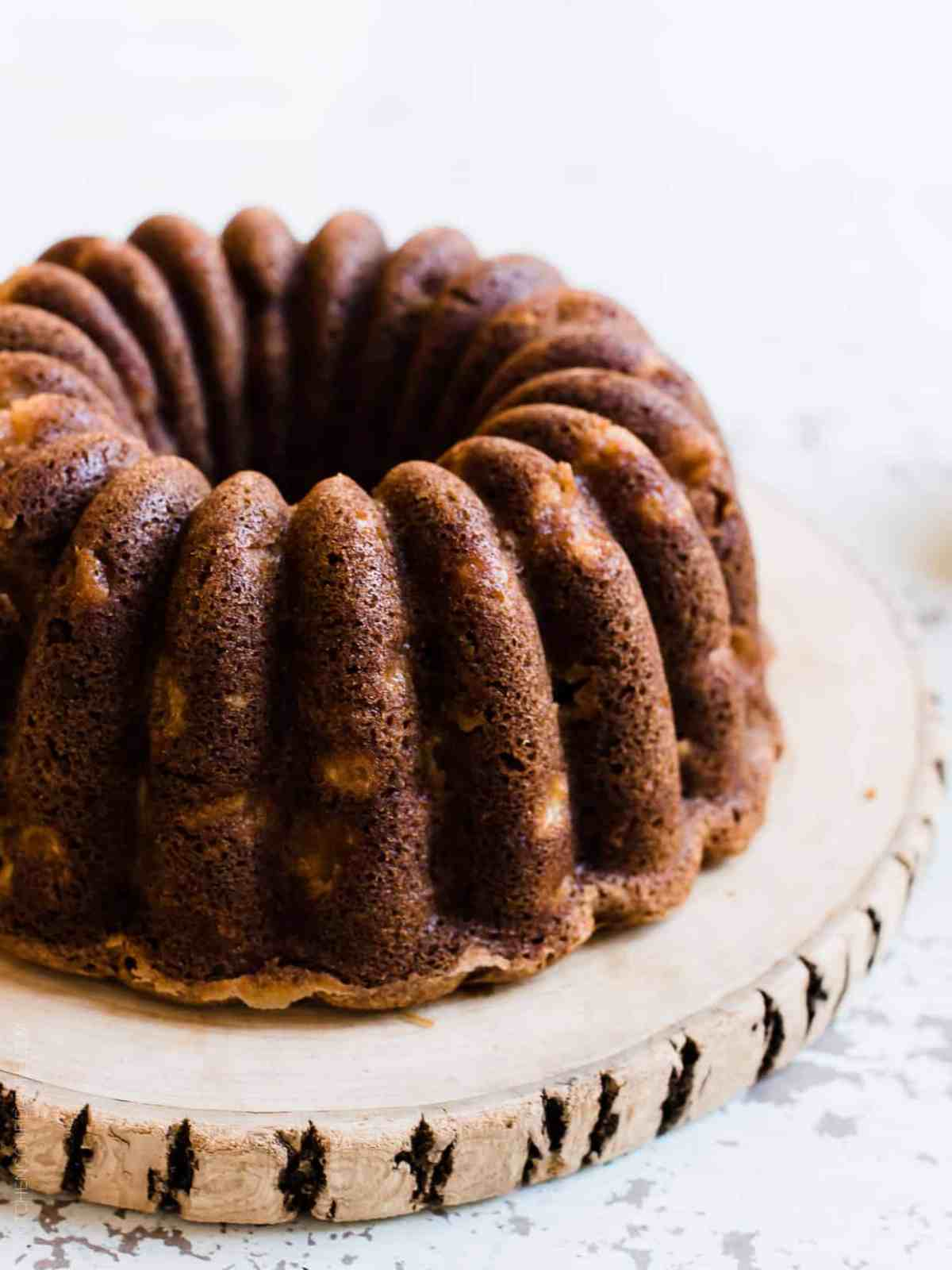Apple Cake baked in a fluted pan and studded with walnuts.