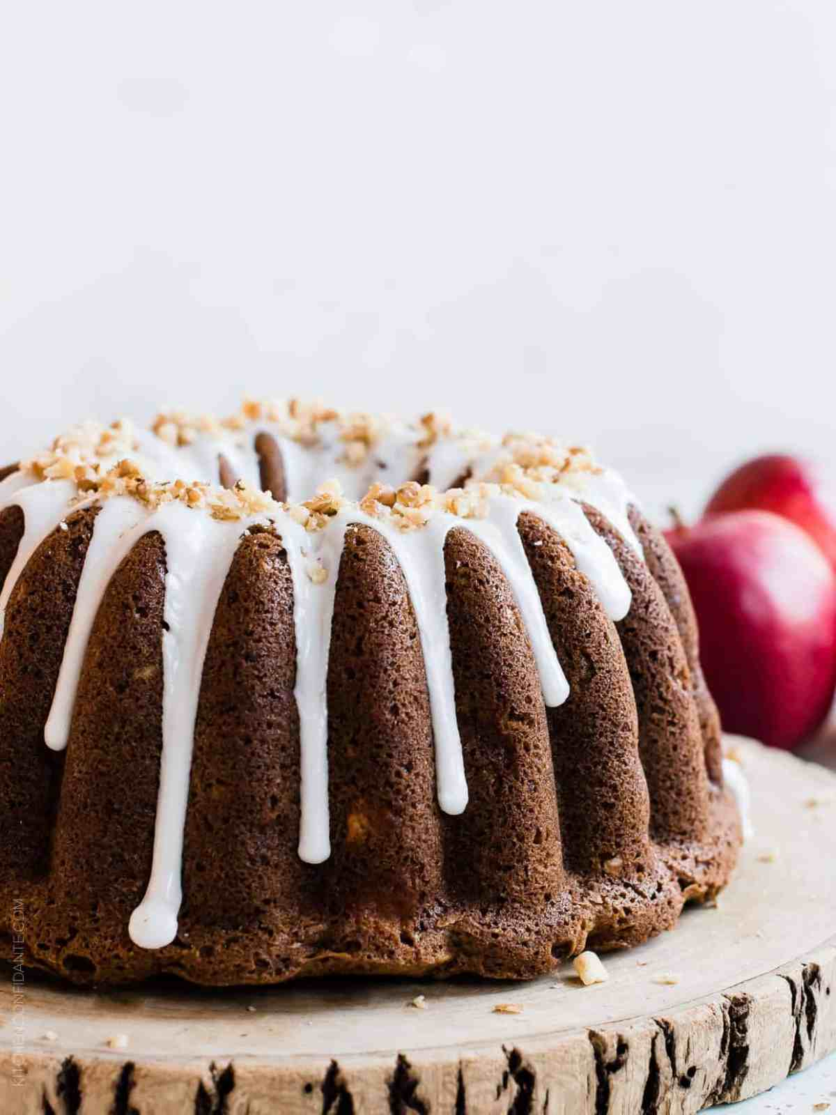 Apple Walnut Cake with apples in the background.