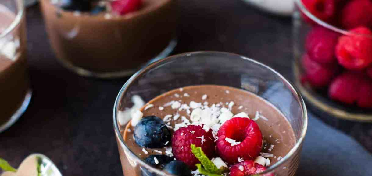 Cheat's Chocolate Hazelnut Mousse topped with berries, white chocolate and coconut.