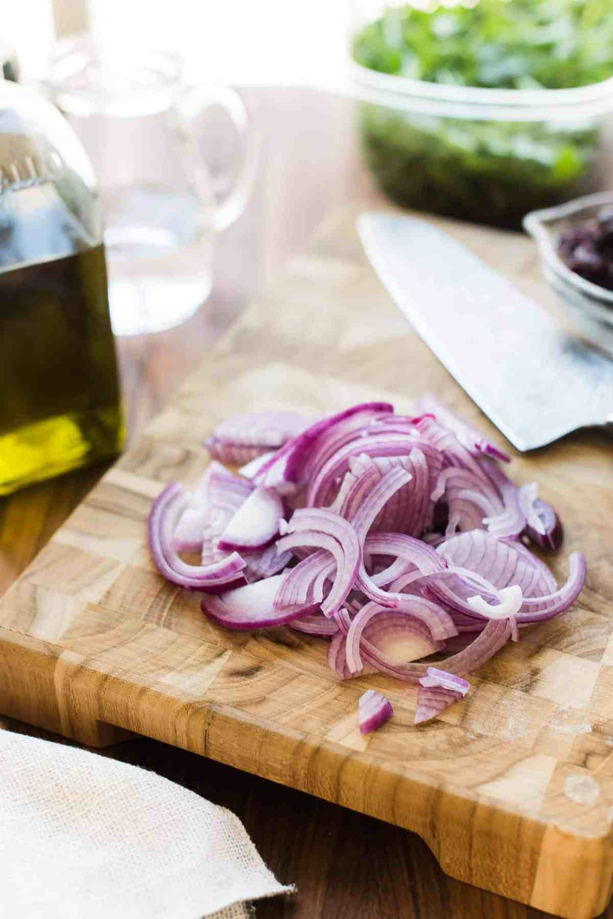 Sliced red onions for  Caramelized Onion, Feta and Serrano Ham Flatbread