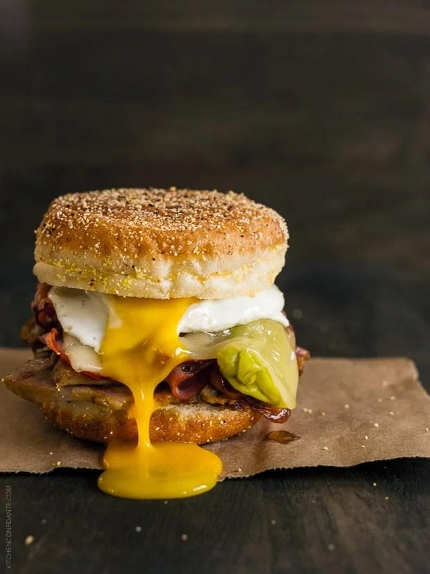 Cubano Breakfast Sandwich | www.kitchenconfidante.com | The ultimate egg sandwich, piled high with roast pork, ham, swiss cheese and pickled pepperocini.