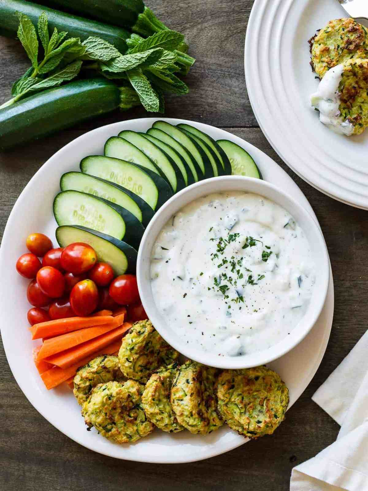 Baked Zucchini Fritters with Ranch Tzatziki - Perfect for snacking or entertaining, these baked fritters let you snack without the guilt.
