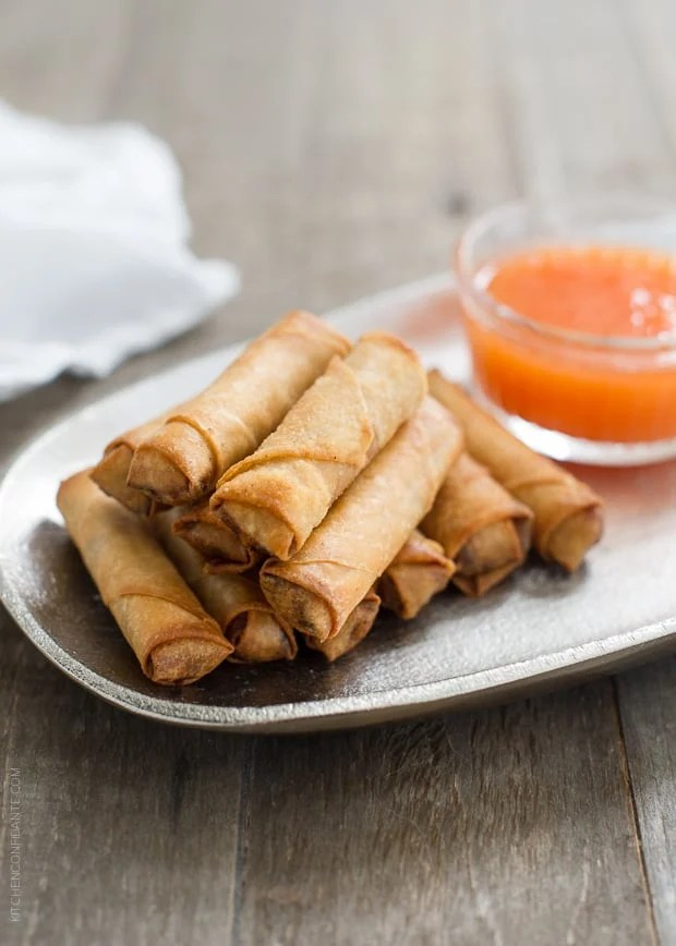 Lumpiang Shanghai - Filipino Spring Rolls (Lumpia) and dipping sauce on a silver serving platter