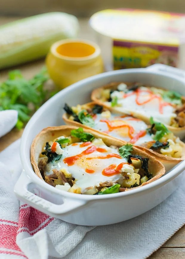 Baked Egg Taco Boats with Pulled Pork, Potatoes and Kale | www.kitchenconfidante.com | Taco Tuesday just got more fun! These taco boats are perfect for busy weeknights.