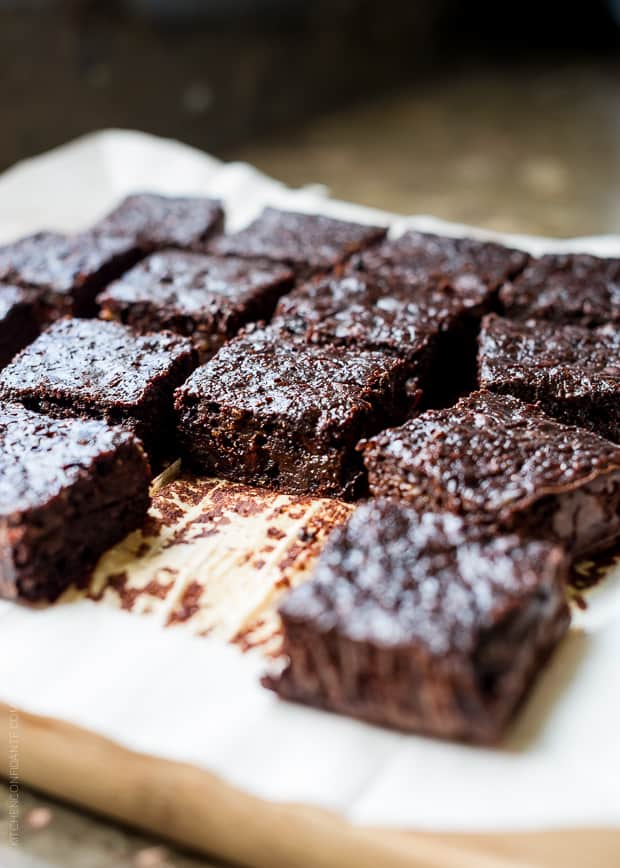 Zucchini Banana Brownies sliced on parchment paper.
