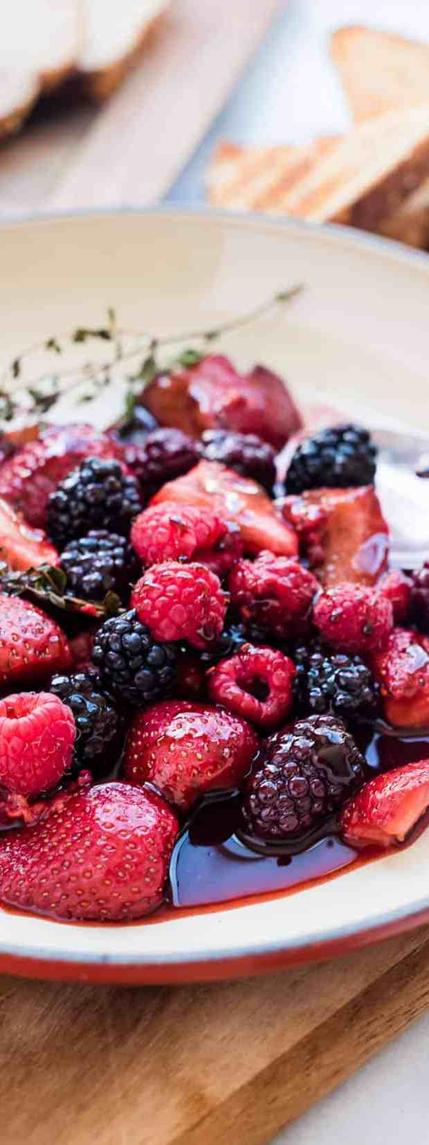 Balsamic berries in a white dish.