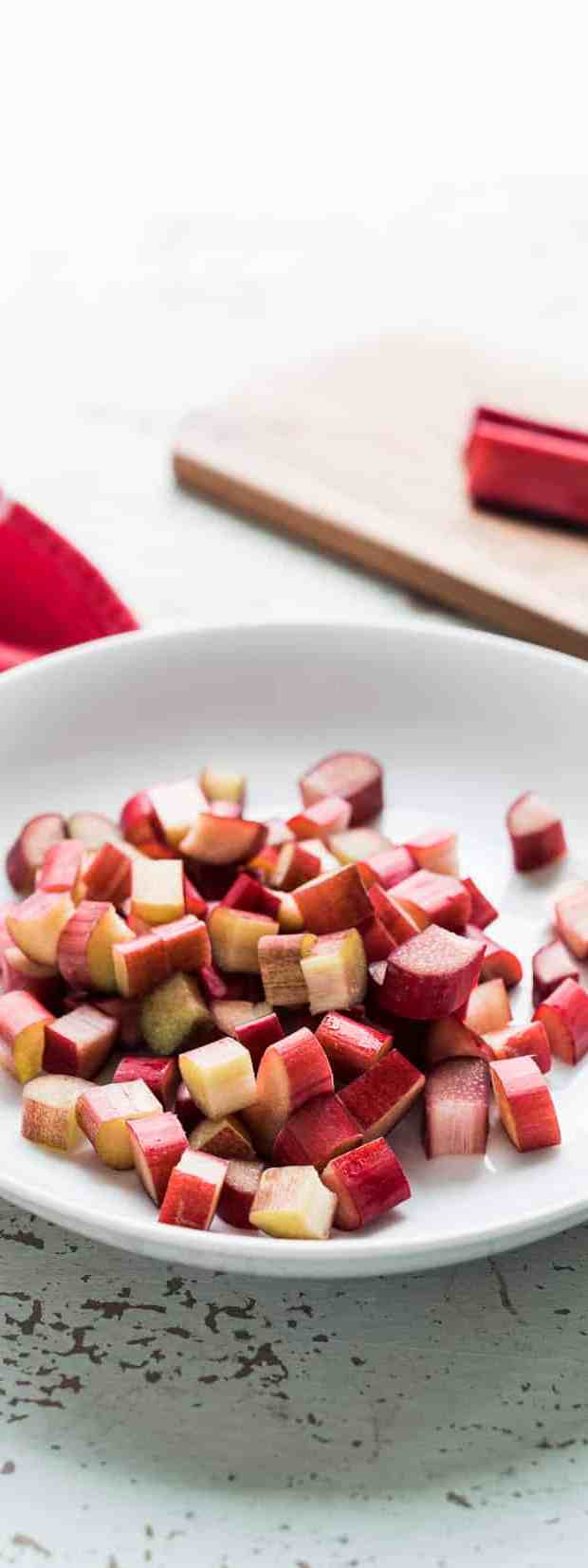 White plate filled with diced rhubarb cubes.