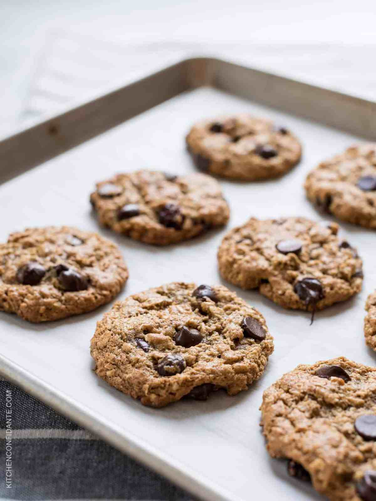 Almond Butter Oatmeal Cookies with chocolate chips on a baking sheet.
