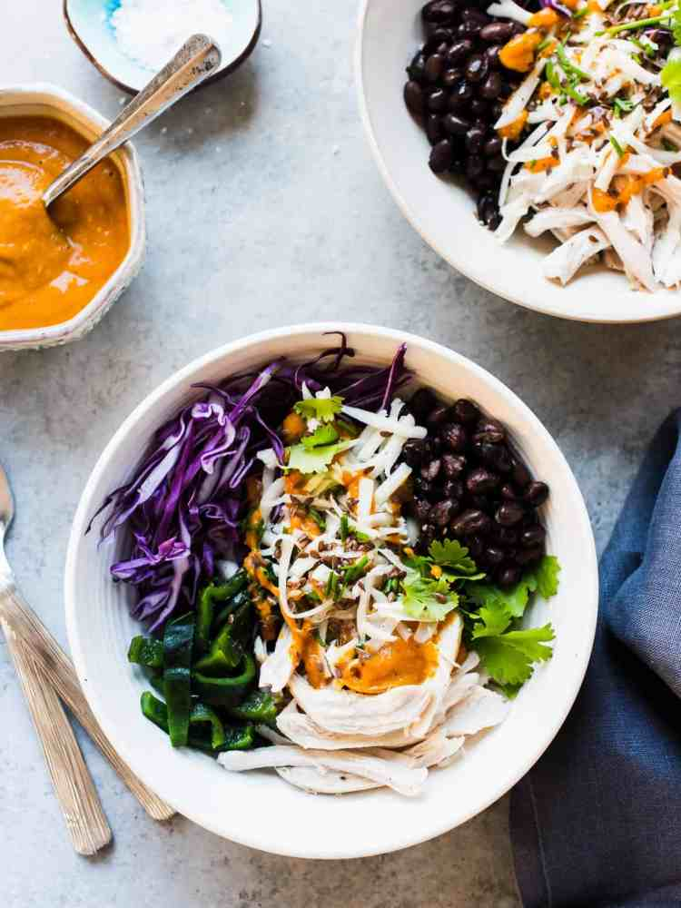 Salad prepared with shredded chicken, cabbage, black beans, charred poblanos, and pumpkin-red curry vinaigrette.