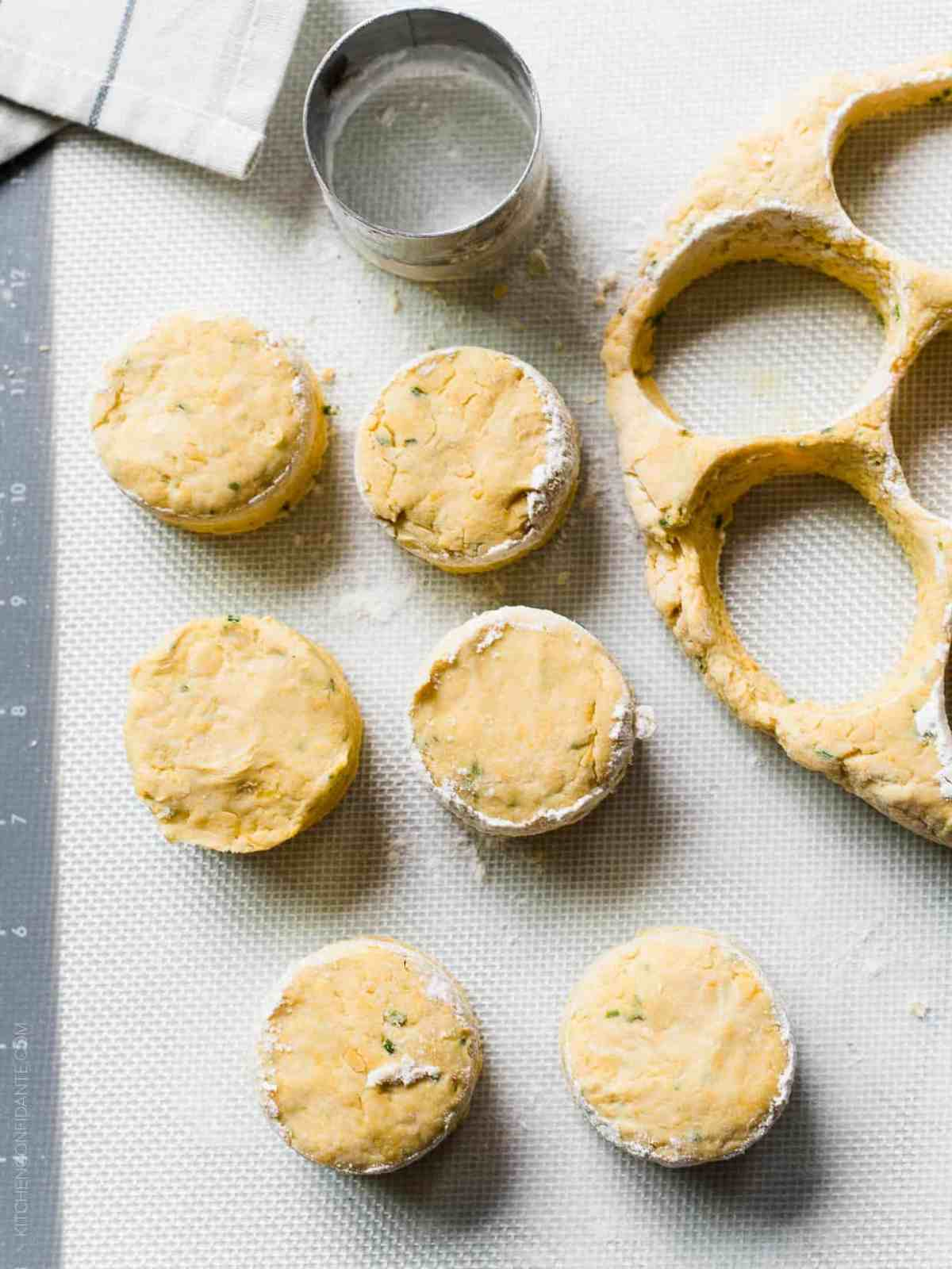 Pumpkin Cheddar Biscuits cut with a round cutter and ready to be baked.