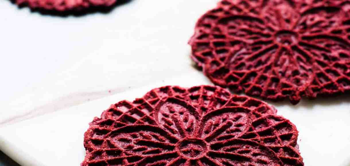 The traditional Italian waffle cookie gets a red velvet twist in this Red Velvet Pizzelle, perfect for sharing with that special someone!