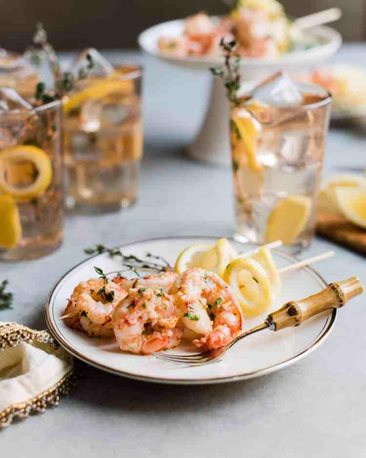 Ginger Lemon Shrimp appetizer served on a white plate with lemon slices.
