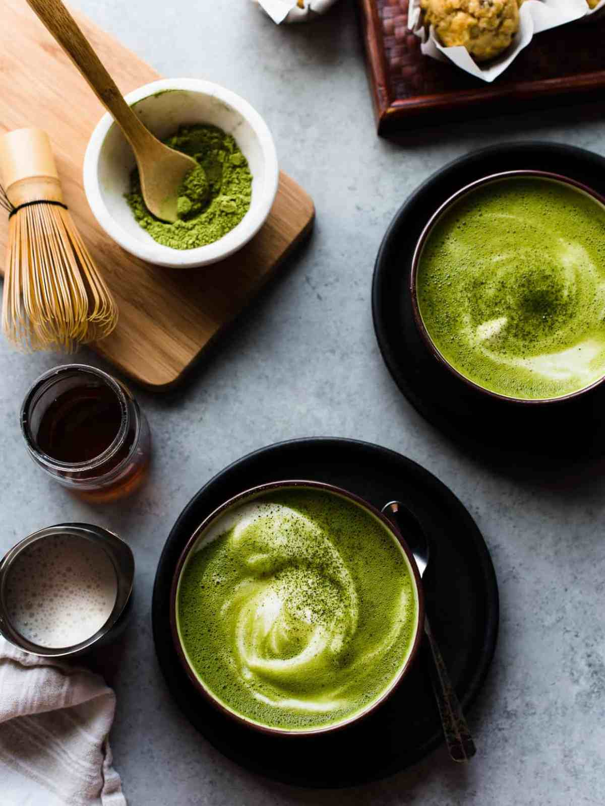 Cozy up with a matcha green tea latte made with almond milk - it is so easy to make at home!  #matcha #greentea #tea #latte #recipe #vegetarian #vegan